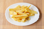 Fried potatoes on white plate. Proper for restaurant menu. — Stock Photo