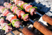 Raw meat skewers on grill — Stock Photo