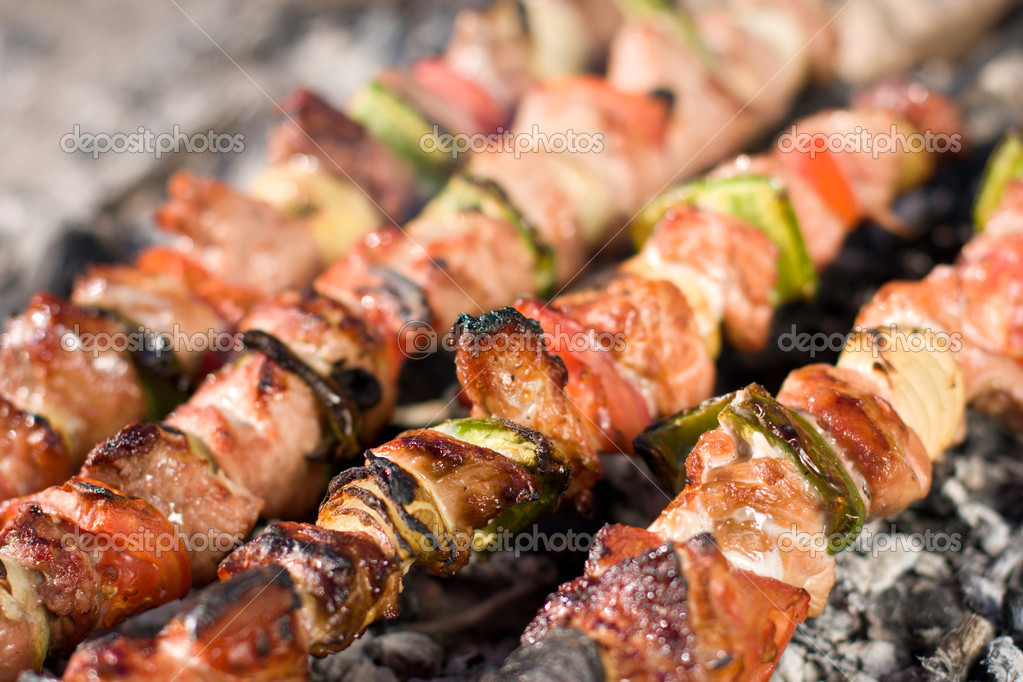 Barbecue with delicious grilled meat on grill — Stock Photo #5823927