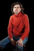 Muž, v červený svetr. — Stock fotografie
