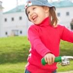 Little girl on bike — Stock Photo #5592800