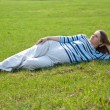 Pregnant woman relaxing on the meadow — Stock Photo