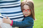 Little girl listen her mother belly — Stock Photo