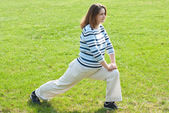 Pregnant woman doing stretching exercises — Stock Photo