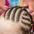 Hairdresser hands weaving dreadlocks — Stock Photo #6006666
