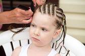 Hairdresser hands weaving a dreadlocks. — Stock Photo