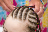 Hairdresser hands weaving a dreadlocks — Stock Photo