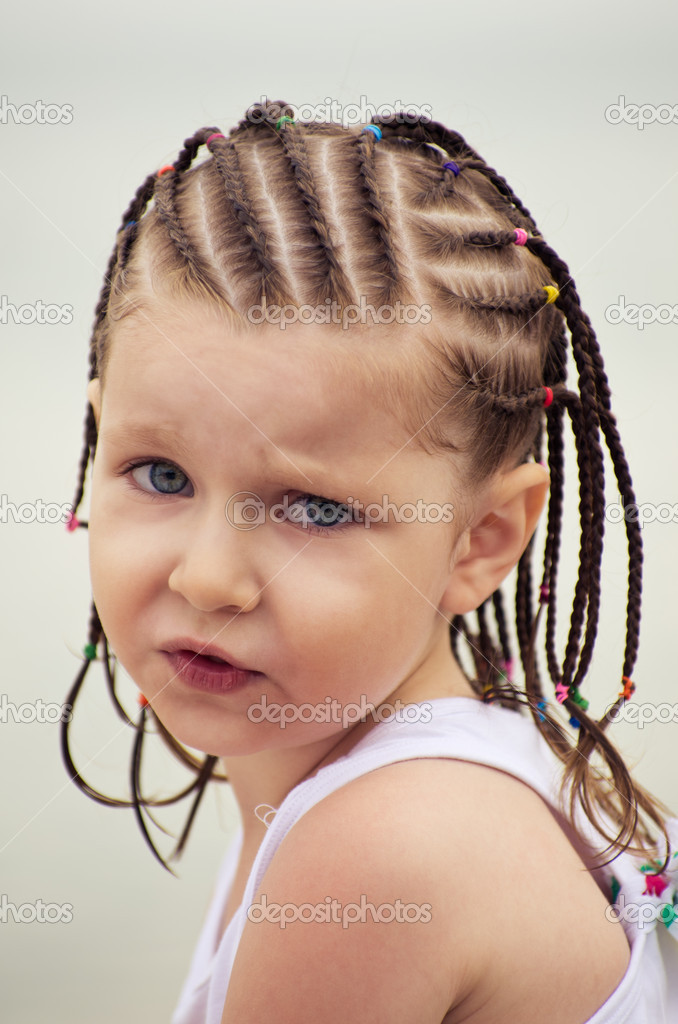 Portrait of little girl with dreadlocks on the beach — Stock Photo #6006655