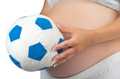 Belly of a pregnant woman with soft toy ball. — Stock Photo
