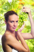 Beautiful blonde with fruits. — Stock Photo