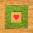 Valentine love heart inside green frame borde — Stock Photo