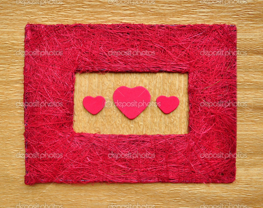 Valentine love heart on crepe paper inside red color frame border made from threads texture. — Stock Photo #5402742