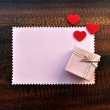 Royalty-Free Stock Photo: Empty pink paper gift card with love hearts and gift box