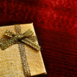 Gift box on table close-up — Stock Photo #6452494