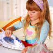 Little girl helping with ironing — Stock Photo #5425977