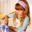 Little girl helping with ironing — Stock Photo