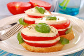 Breakfast with mozzarella and tomato — Stock Photo