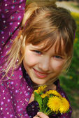 Young girl with dandelions — Stock Photo