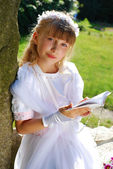 Girl going to the first holy communion — Photo