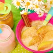 Stock Photo: Rice pudding with with apple and cinnamon for baby