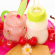 Cherry yogurt and bottle of milk for baby — Stock Photo