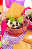 Blueberry jelly with semolina and biscuit for baby — Stock Photo