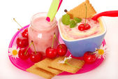 Yogurt and rice pudding with cherry for baby — Stock Photo