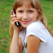 Young girl with mobile phone — Stock Photo