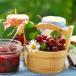 Cherry preserves in the garden - Stock Photo