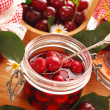 Jars of cherry compote — Stock Photo