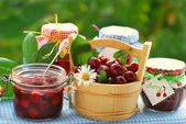 Cherry preserves in the garden — Stock Photo