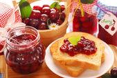Breakfast with cherry preserves — Stock Photo