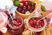 Jars of cherry preserves — Stock Photo