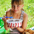 Young girl eating ice cream on the picnic — Stock Photo #6143407