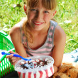 Stock Photo: Young girl eating ice cream on the picnic