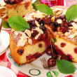 Homemade cherry cake with almonds - Stock Photo