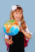Schoolgirl with globe — Stock Photo