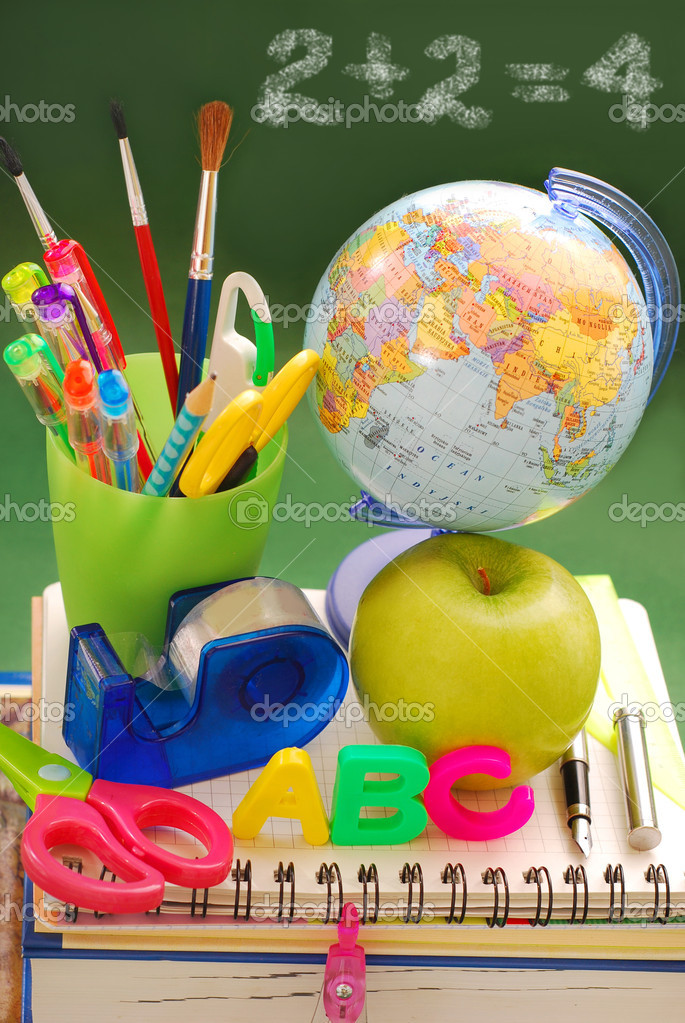 School equipment ,apple and globe against to  green chalkboard — Stock Photo #6216997
