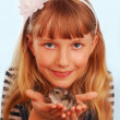 Stock Photo: Young girl with her hamster