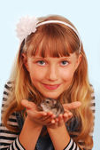 Young girl with her hamster — Stock Photo