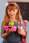 Schoolgirl with lunch box — Stock Photo