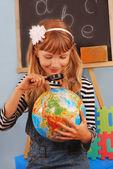Schoolgirl in the classroom — Stock Photo