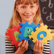 Schoolgirl holding letters puzzle — Stock Photo