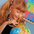 Royalty-Free Stock Photo: Schoolgirl with globe
