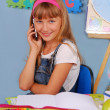 Schoolgirl with mobile phone — Stock Photo #6326021