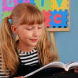 Schoolgirl reading a book — Stock Photo