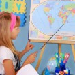 Schoolgirl on geography lesson — Stock Photo