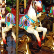 Beautiful merry-go-round with horses — Stock Photo