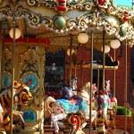 Beautiful merry-go-round with horses — Stock Photo