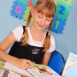 Schoolgirl drawing a picture — Stock Photo #6450925